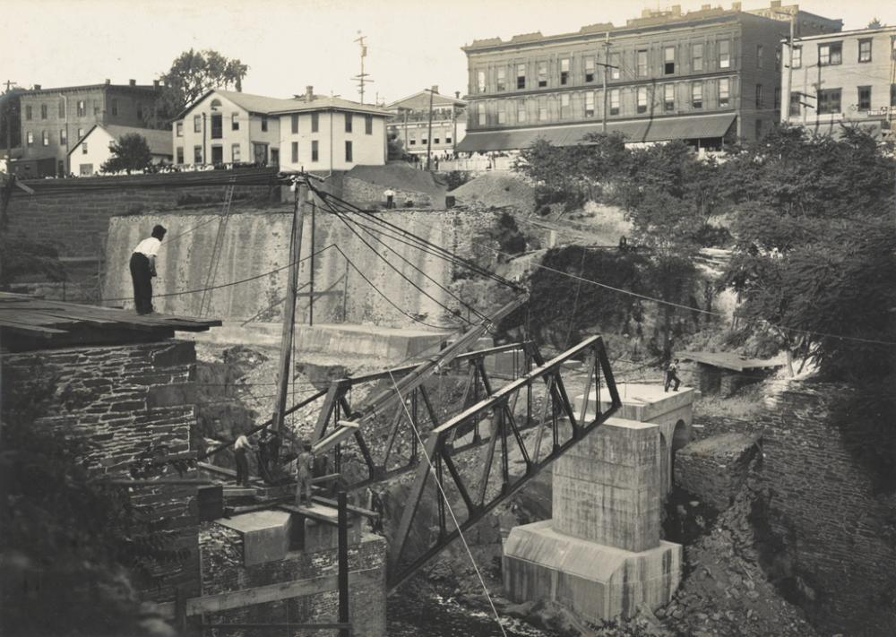 (EVIDENCE--WAPPINGERS FALLS, NEW YORK) A series of 14 photographs, accompanied by affidavits, relating to a construction accident at a