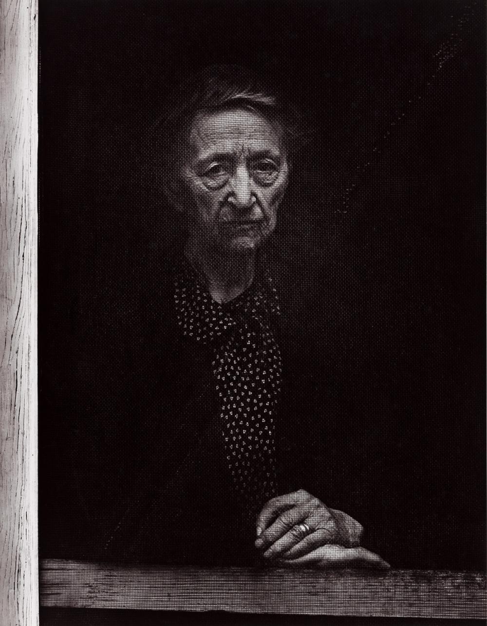 ANSEL ADAMS (1902-1984) Woman Behind Screen Door, Independence, California.
