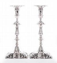 A pair of cast silver candlesticks, by Asprey &