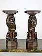 A pair of carved oak capitals in the form of