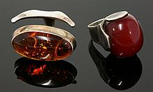 A single stone amber ring, c.1960, a large oval