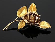A gold rose brooch, c.1960, with a