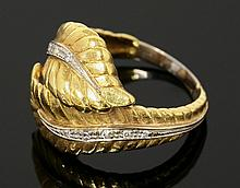 A Continental diamond set gold crossover leaf