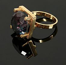 A 9ct gold modernist single stone synthetic