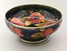 A Moorcroft 'Pomegranate' pottery bowl, mounted on