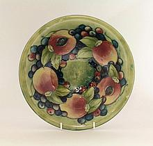 A Moorcroft 'Pomegranate' Dish, c.1928, with an