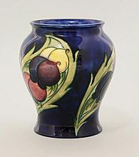 A Moorcroft 'Wisteria' vase, c.1925, with a banded