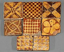 Eight heraldic-style encaustic Tiles, 13th-15th