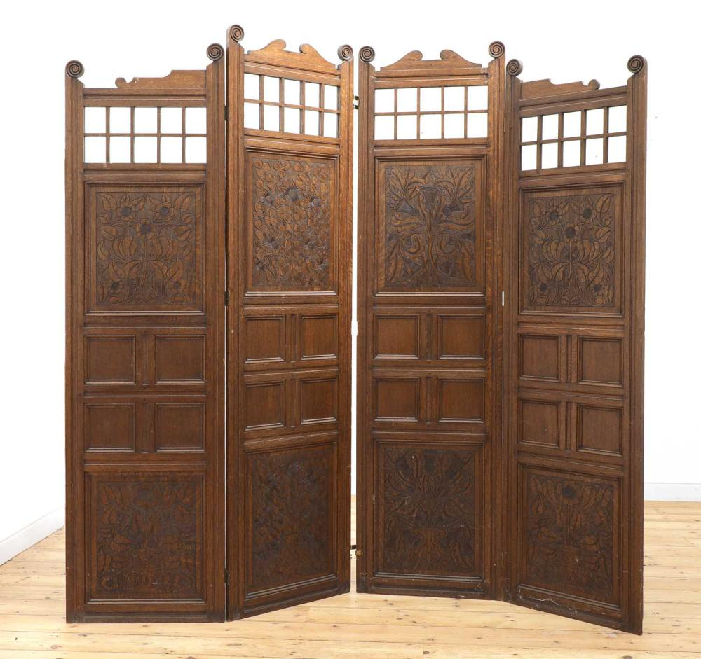An Arts and Crafts oak four-fold dressing screen,
