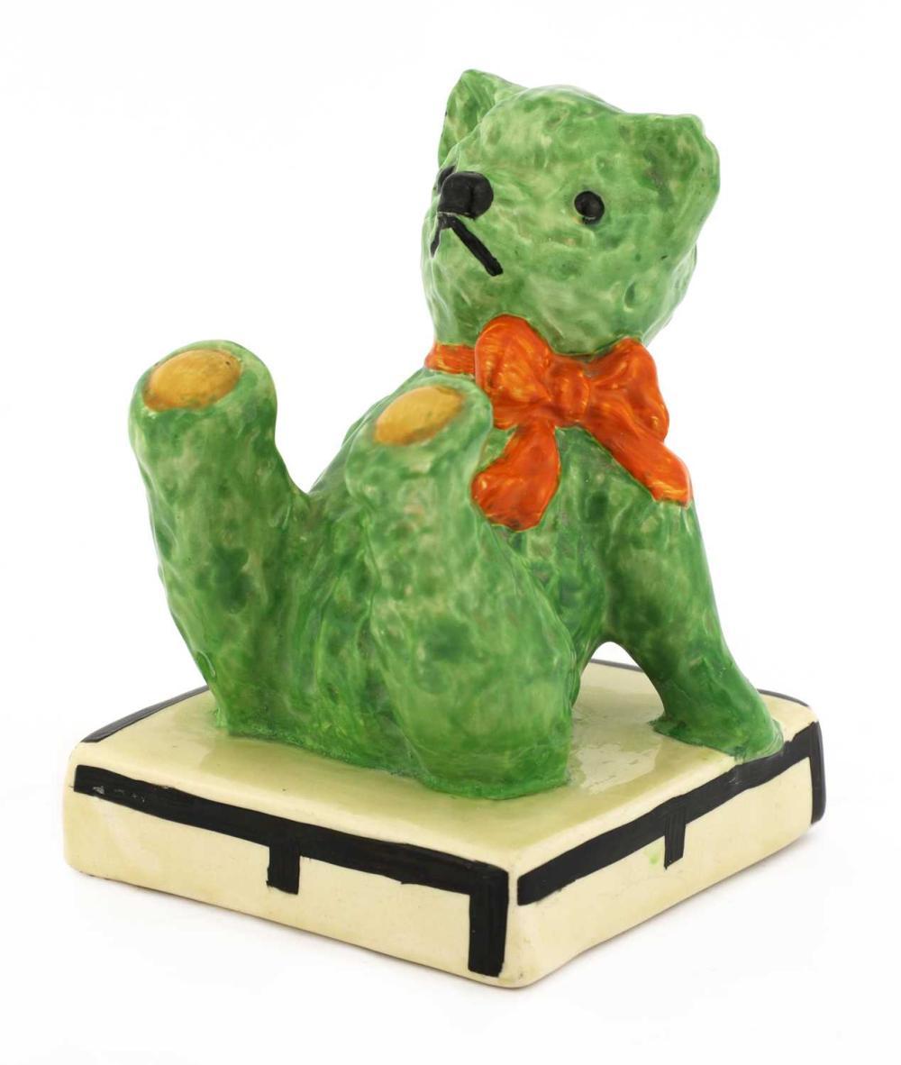 A Clarice Cliff teddy bear bookend,