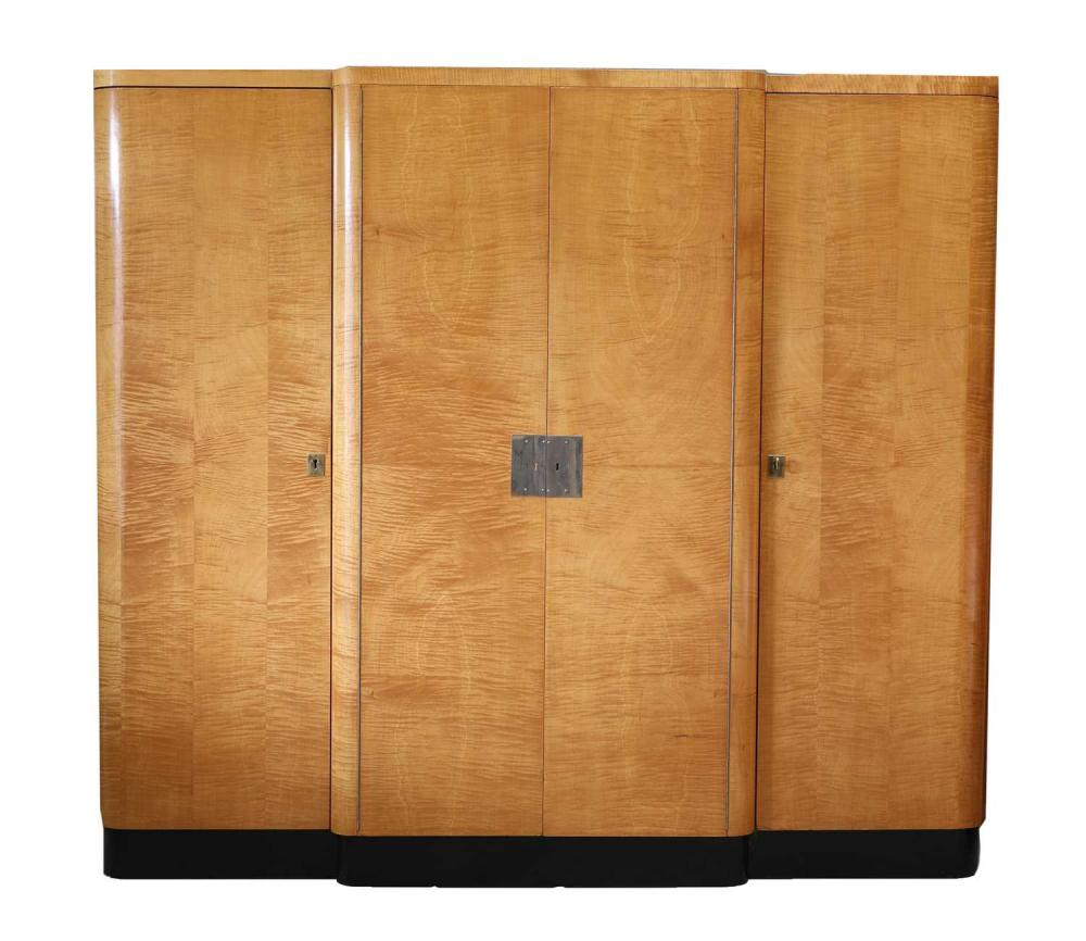 An Art Deco maple and ebonised breakfront wardrobe,