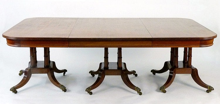 A Georgian-style mahogany triple pillar dining