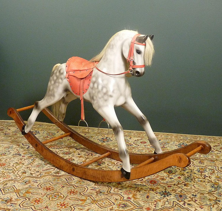 A hand made wooden rocking horse by john marriott for Hand crafted rocking horse