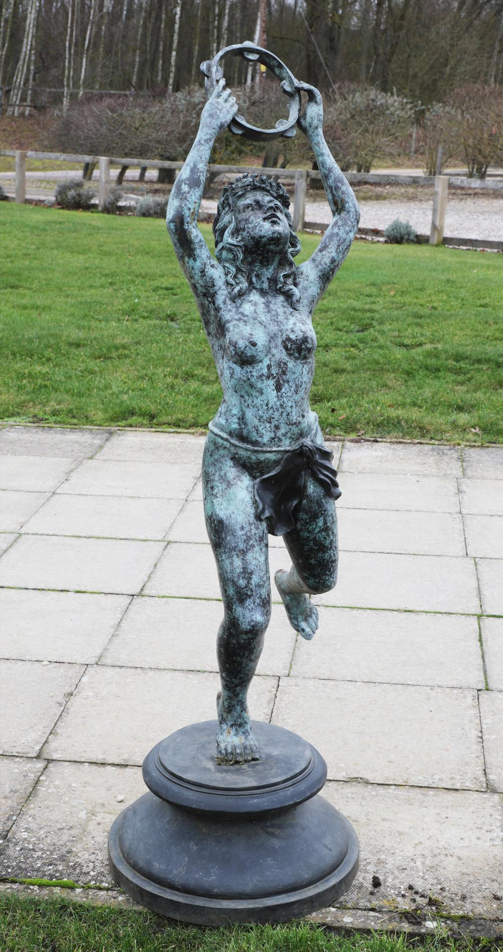 A bronze of a tambourine dancer,