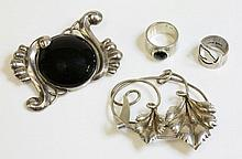 A Mexican silver and onyx brooch, by Fred Davis,