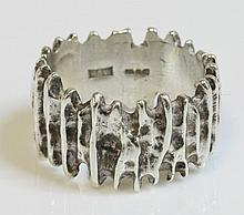 A sterling silver band ring, c.1960, by Peter Guy
