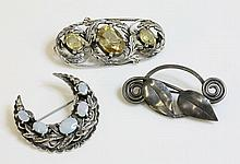 A three stone citrine brooch, in the style of