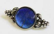 An Arts and Crafts butterfly wing brooch, with a