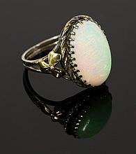 An Arts and Crafts single stone opal ring, with an