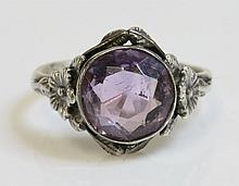 An Arts and Crafts silver single stone amethyst