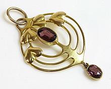 A gold Edwardian garnet pendant, by Murrle Bennett