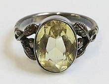 An Arts and Crafts silver single stone citrine