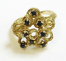 A 9ct gold sapphire ring, c.1970, with a staggered