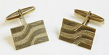 A pair of 9ct gold cufflinks, with swivel