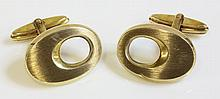 A pair of 9ct gold cufflinks, c.1970, with a