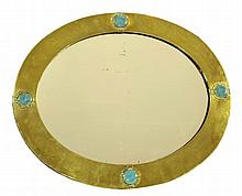 A brass hall mirror, by Liberty & Co., the brass