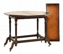 A walnut octagonal centre table, with leather top,