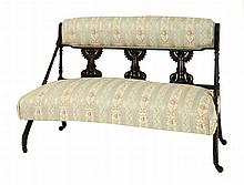 An Aesthetic settee, possibly after a design by Dr