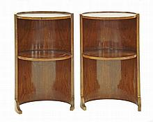 A pair of walnut bedside tables, of cylindrical