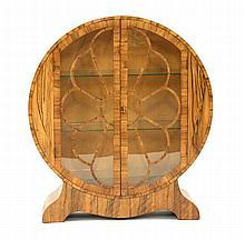 An Art Deco walnut display cabinet, of circular
