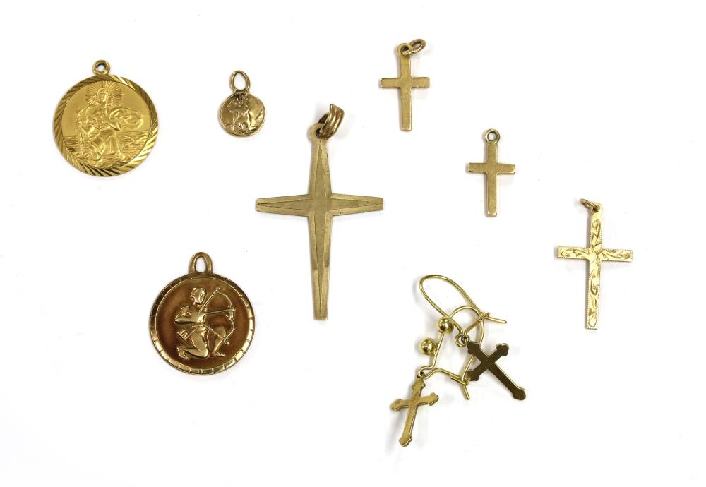 Four 9ct gold cross pendants,