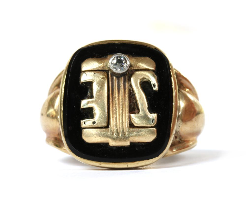 A gold onyx and diamond signet ring,