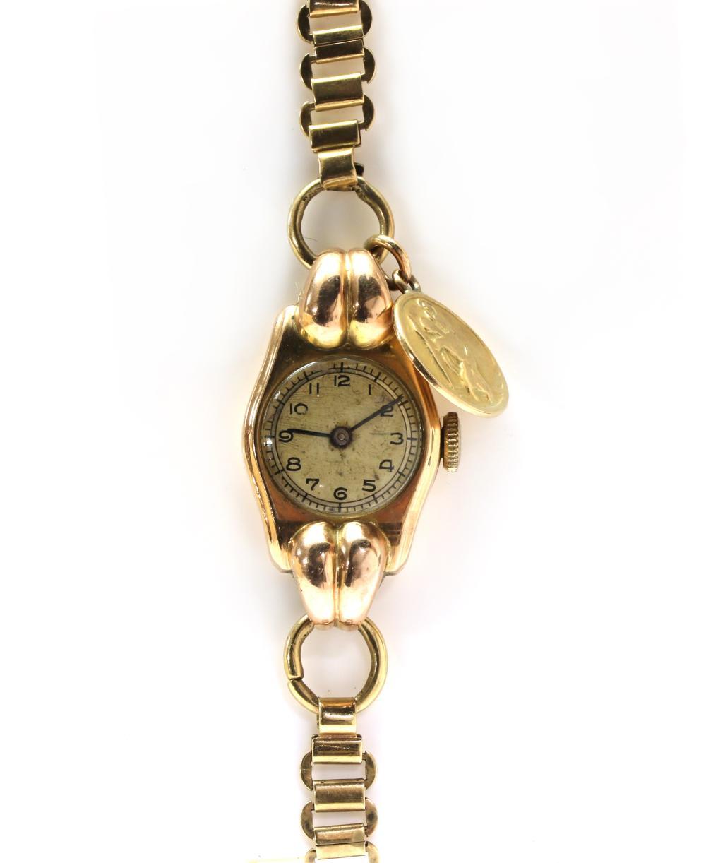 A ladies' 9ct gold mechanical bracelet watch,