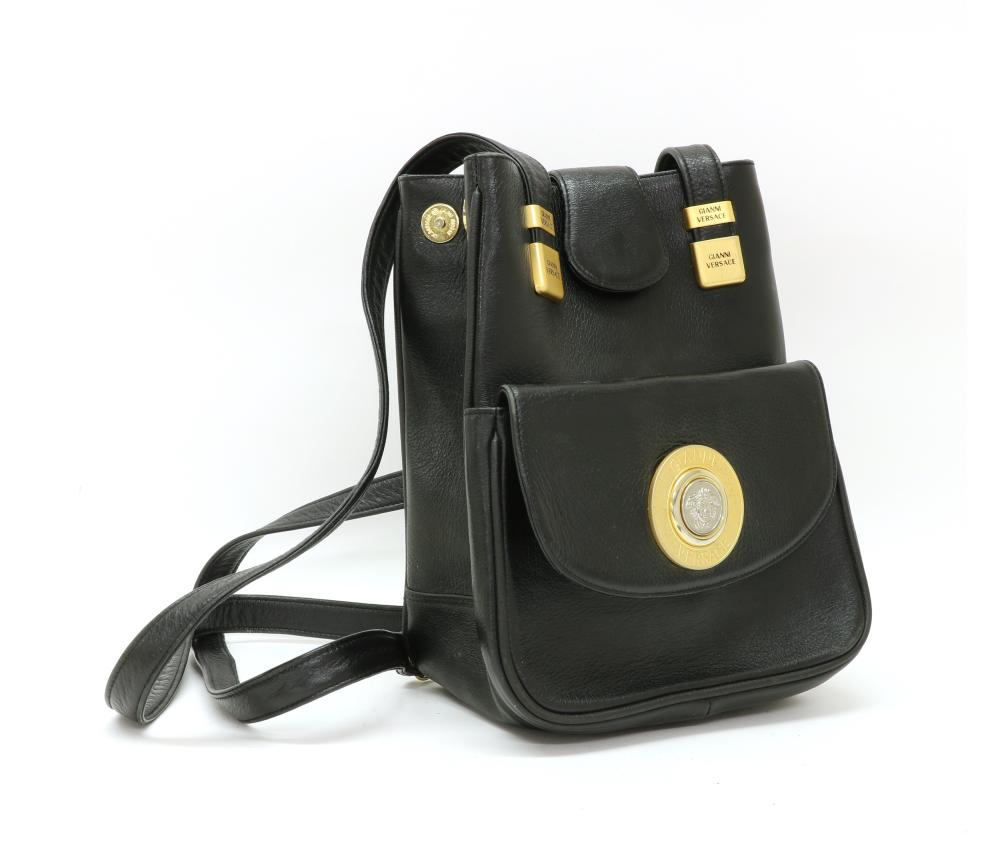 A Versace black leather backpack,