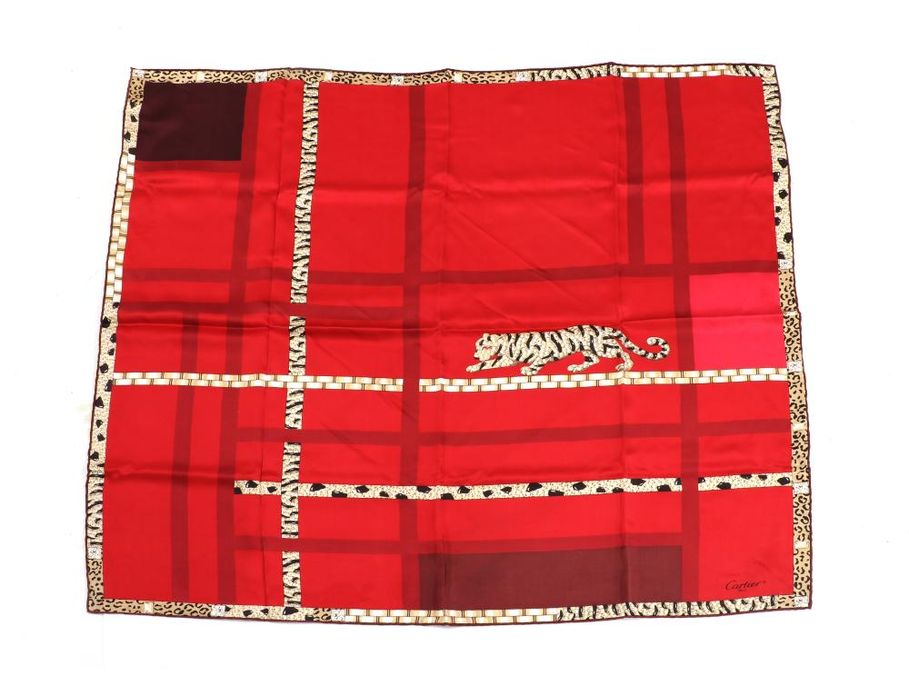 A Cartier red silk panther scarf,