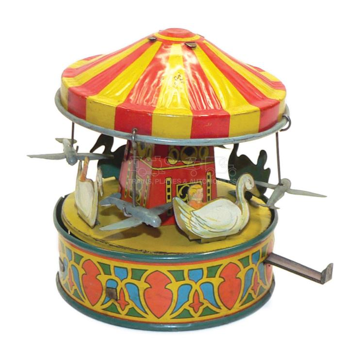 Wyandotte tinplate clockwork Carousel