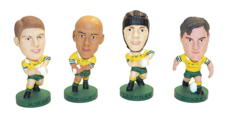 Four Corinthian plastic ARU Football Figurines