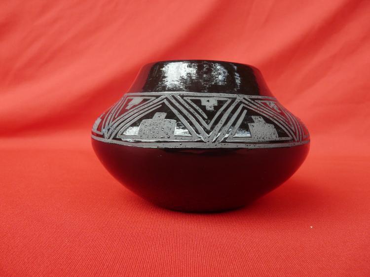 Black Ceramic Pot With Design On Inside Of Pot