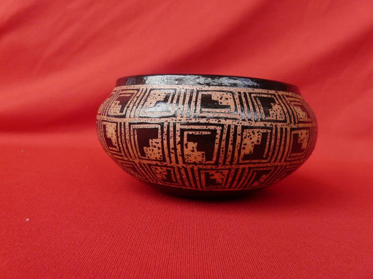 Micaceous Clay With A Design On The Inside Of Pot