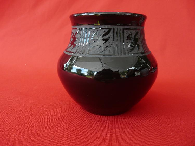 Black Handmade Pot With Design On The Inside