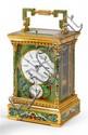 """CHAUMET PENDULETTE DE VOYAGE """"TOURBILLON"""" N° 32 Début du XXème Pendulette en laiton doré et vitrée sur 4 faces à décor de rinceaux e..."""
