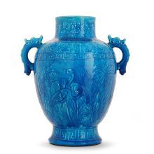 LONGWY Vase en faïence d''inspiration chinoise, corps pansu à décor en bas-relief de hérons, végétaux et frises géométriques, émaux b...