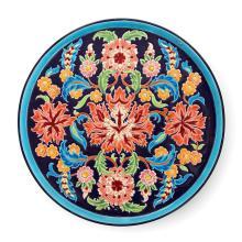 LONGWY Grand plat circulaire en faïence à décor floral émaillé cloisonné polychrome sur fond bleu nuit