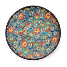 LONGWY Coupe circulaire en faïence sur piédouche à décor en émail cloisonné de fleurs polychromes sur fond bleu