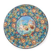 LONGWY Grand plat circulaire en faïence à décor central de hérons, fond de fleurs polychromes sur fond bleu en émail craquelé