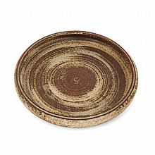 CARL HALLIER (1892-1953) & ROYAL COPENHAGUE (MANUFACTURE) A stoneware dish, beige, ochre and brown enamels